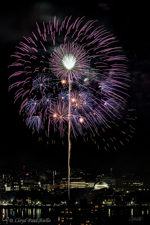 The July 4, 2018 Boston Massachusetts fireworks celebration lights the sky over the MIT Dome and campus.  Over 10,000 pyrotechnic explosions initiated by over 4,000 computer comands originate from barges in the Charles River and the Massachusetts Avenue bridge.  The fireworks can soar as high as 1,500 feet into the summer night sky.  This spectacular event has been a tradition in Boston since 1974.