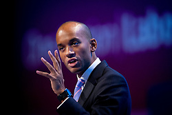 © London News Pictures. 23/09/2013 . Brighton, UK.   Shadow Business Secretary CHUKA UMUNNA speaking on day two of the Labour Party Annual Conference in Brighton. Photo credit : Ben Cawthra/LNP