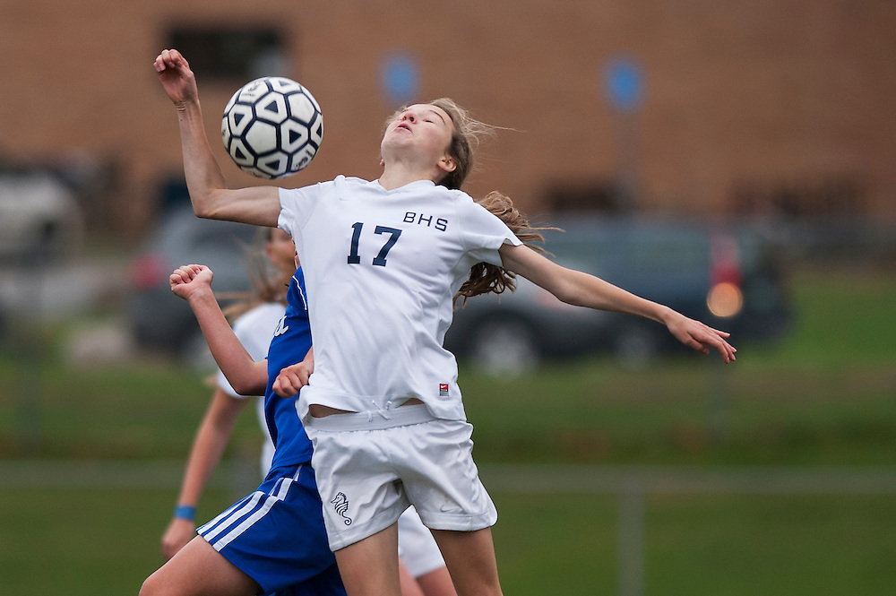 Burlington's Fiona Dunn (17) heads the ball during the girls playoff soccer game between the U-32 Raiders and the Burlington Sea Horses at Buck Hard Field on Friday afternoon October 24, 2014 in Burlington, Vermont (BRIAN JENKINS, for the Free Press)