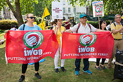 London, UK. 1 June, 2019. Members of the Independent Workers of Great Britain (IWGB) and United Voices of the World (UVW) grassroots trade unions meet in Cavendish Square before a protest inside the DoubleTree Hilton Hotel in solidarity with Dalia Quinonez Guerrero, a former cleaner from whom wages were withheld. The protest was previously arranged to have taken place outside Chanel but arrangements were changed after the global fashion chain agreed to pay its cleaners the London Living Wage at its stores.