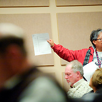 """013013  Adron Gardner<br /> <br /> Doris Benallie, of Tohatchi, holds up a printed statement of House Bill 71 at a University of New Mexico Gallup local advisory board meeting in Gallup Wednesday.  """"I, as a parent, support this bill,"""" Benallie said."""