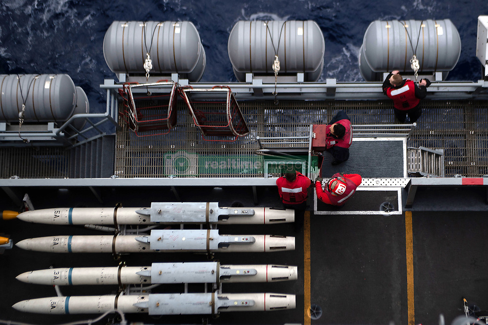 PACIFIC OCEAN (Aug. 23, 2018) Sailors prepare for a vertical replenishment on the flight deck aboard the Nimitz-class aircraft carrier USS John C. Stennis (CVN 74). John C. Stennis is underway conducting routine operations in the U.S. 3rd Fleet area of operations. (U.S. Navy photo by Mass Communication Specialist Seaman Apprentice Joshua L. Leonard/Released)180823-N-IL409-0093