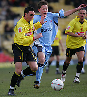 Photo:  Frances Leader.<br /> Watford v Coventry City. Coca Cola Championship. <br /> Vicarage Road Stadium<br /> 05/03/2005<br /> Watford's Chris Eagles and Coventry's Stephen Hughes battle for the ball