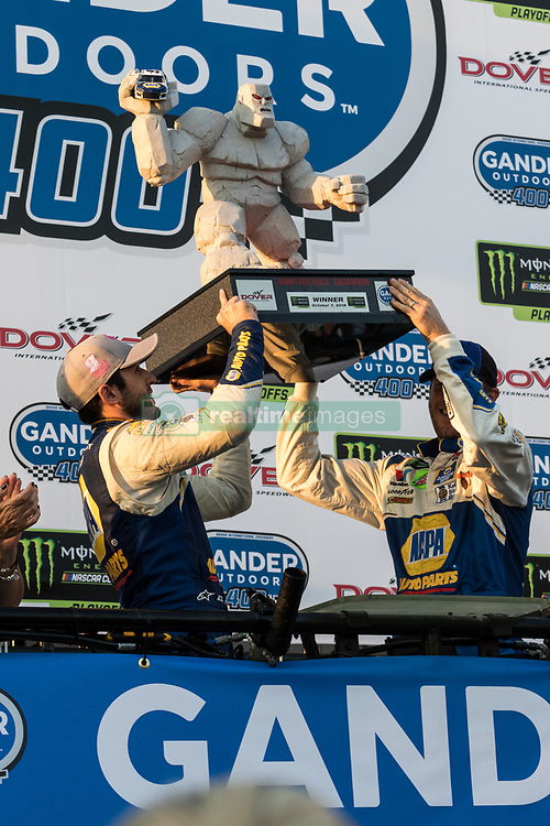 October 7, 2018 - Dover, DE, U.S. - DOVER, DE - OCTOBER 07: Chase Elliott and Alan Gustafson, crew chief, hoist the trophy after Elliot wins the Gander Outdoors 400 on October 07, 2018, at Dover International Speedway in Dover, DE. (Photo by David Hahn/Icon Sportswire) (Credit Image: © David Hahn/Icon SMI via ZUMA Press)