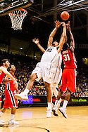 December 28th, 2013:  Colorado Buffaloes sophomore forward Josh Scott (40) and Georgia Bulldogs sophomore forward Brandon Morris (31) battle for the ball in the second half of the NCAA Basketball game between the Georgia Bulldogs and the University of Colorado Buffaloes at the Coors Events Center in Boulder, Colorado