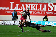 Liam Williams of the Scarlets evades a tackle by Eoin Griffin of Connacht as he tries to break down the wing  Guinness Pro12 rugby match, Scarlets  v Connacht at the Parc y Scarlets in Llanelli, West Wales on Saturday 24th September 2016.<br /> pic by  Andrew Orchard, Andrew Orchard sports photography.