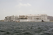 India, Rajasthan, Udaipur A boat ride in lake Pichola, The Taj Lake palace hotel.