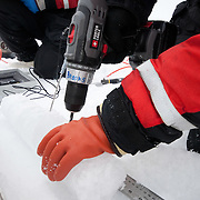 Mette Kaufman drills holes in an ice core for placing a thermometer in to take temperature profiles. Arctic Ocean