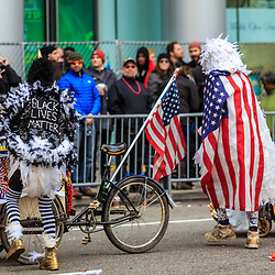 Philadelphia, PA, USA - January 1, 2016: At the annual New Year's Day Mummers Parade, one participant wears a Black Lives Matter sign on his costume in downtown Philadelphia.