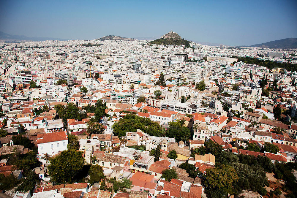 View from the Acropolis across Plaka towards Lykavittos Hill. Mount Lycabettus, also known as Lycabettos, Lykabettos or Lykavittos is a Cretaceous limestone hill in Athens, Greece. At 277 meters (908 feet) above sea level, the hill is the highest point in the city that surrounds it. Pine trees cover its base, and at its peak is the 19th century Chapel of St. George. The hill is a popular tourist destination and can be ascended by the Lycabettus Funicular, a funicular railway which climbs the hill from a lower terminus at Kolonaki Athens is the capital and largest city of Greece. It dominates the Attica periphery and is one of the world's oldest cities, as its recorded history spans around 3,400 years. Classical Athens was a powerful city-state. A centre for the arts, learning and philosophy.