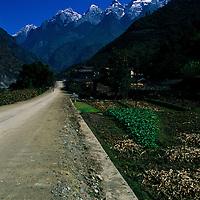 Country road leads to Jade Dragon Mountain, Lijiang, China