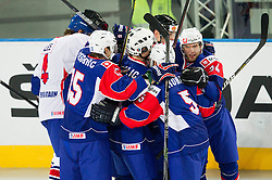 Players of Slovenia celebrate during ice-hockey match bewteen Great Britain and Slovenia at IIHF World Championship DIV. I Group A Slovenia 2012, on April 15, 2012 in Arena Stozice, Ljubljana, Slovenia. (Photo by Vid Ponikvar / Sportida.com)