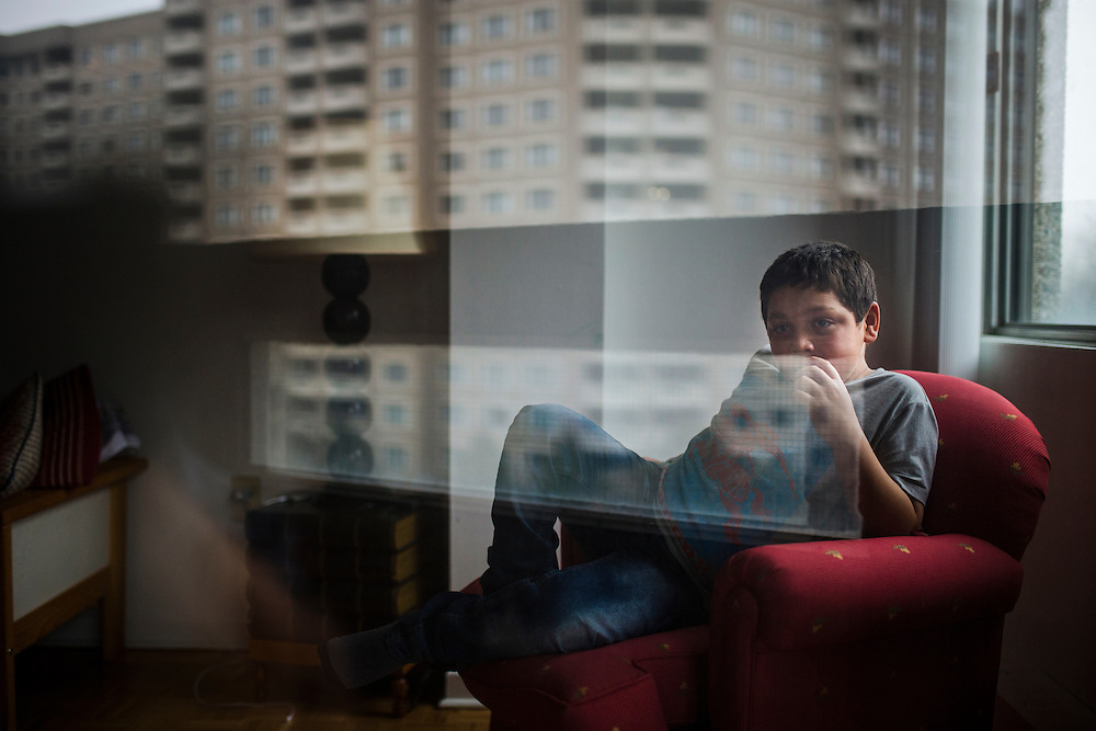 Syrian refugee Nasimi Batal Al Hasan is looks on from inside their apartment in Mississauga, Ontario, Canada, Thursday January 21, 2016.   (Mark Blinch for the BBC)