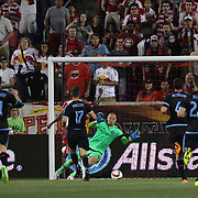 Bradley Wright-Phillips, New York Red Bulls, scores his sides second goal beating goalkeeper Josh Saunders, NYCFC, during the New York Red Bulls Vs NYCFC, MLS regular season match at Red Bull Arena, Harrison, New Jersey. USA. 10th May 2015. Photo Tim Clayton