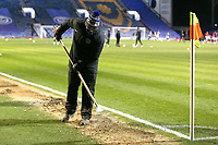 Football - 2020 / 2021 Sky Bet League One - Portsmouth vs. Swindon Town - Fratton Park<br /> <br /> A member of the Pompey Groundstaff tries to break up the frozen sand where the referee's assistant will be running the line at Fratton Park <br /> <br /> COLORSPORT/SHAUN BOGGUST