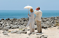 File photo dated 17/03/09 of the Prince of Wales and the Duchess of Cornwall standing and taking in the scene on the Beach of North Seymour Island in the Galapagos Islands. Charles and Camilla are celebrating their 15th wedding anniversary on Friday, after they were reunited on Monday when the 72-year-old duchess came out of a 14-day self-isolation on the Balmoral estate in Aberdeenshire.