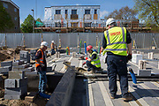 Builders laying the foundations of a new house on a home building construction site in Norwich. Norfolk. United Kingdom.