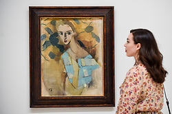 "© Licensed to London News Pictures. 17/07/2019. LONDON, UK. A staff member views ""Girl from Eydtkuhne II"", 1927, by Helene Schjerfbeck at the preview of the first solo UK exhibition of Finnish artist Helene Schjerfbeck at the Royal Academy of Arts in Piccadilly.  The exhibition features around 65 portraits, landscapes and still lifes and runs 20 July to 27 October 2019.  Photo credit: Stephen Chung/LNP"