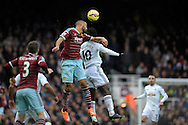 Winston Reid of West Ham United (c) heads the ball over Wilfried Bony of Swansea City. Barclays Premier league match, West Ham Utd v Swansea city at the Boleyn ground, Upton Park in London on Sunday 7th December 2014.<br /> pic by John Patrick Fletcher, Andrew Orchard sports photography.