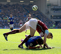 Burnley's Michael Duff takes a tumble with Everton's Leighton Baines<br /> <br /> Photographer Stephen White/CameraSport<br /> <br /> Football - Barclays Premiership - Everton v Burnley - Saturday 18th April 2015 - Goodison Park - Everton<br /> <br /> © CameraSport - 43 Linden Ave. Countesthorpe. Leicester. England. LE8 5PG - Tel: +44 (0) 116 277 4147 - admin@camerasport.com - www.camerasport.com