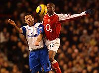 Photo: Daniel Hambury, Digitalsport<br /> Arsenal V Crystal Palace.<br /> FA Barclays Premiership.<br /> 14/02/2005.<br /> Arsenal's Lauren and Palace's Dougie Freedman
