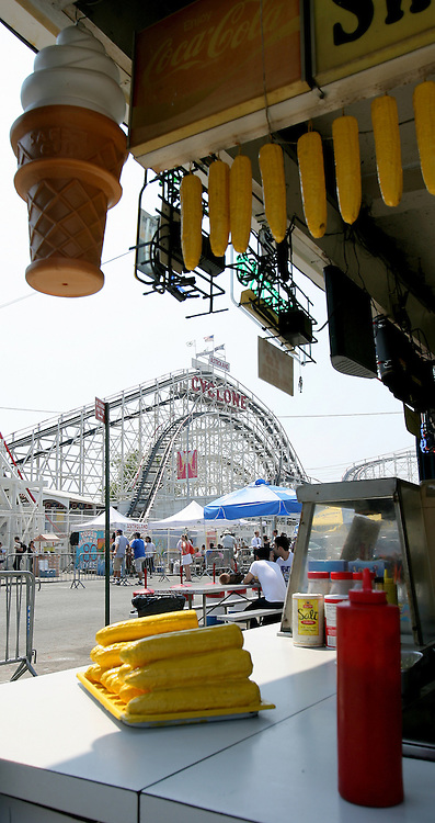 The Cyclone roller coaster is seen with a vending stand in the foreground during an 80th anniversary celebration famous ride in the Coney Island area of Brooklyn, New York on 26 June 2007.