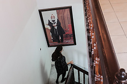 April 3, 2017 - Kfar Chabad, Israel - A woman descends the stairs below a portrait of the 'Rebbe' in '770' in the village of Kfar Chabad. The building is a replica of '770', the Chabad headquarters at 770 Eastern Parkway, Crown Heights, Brooklyn, New York, and includes the exact number of bricks as on the original structure. Chabad Lubavitz is an Orthodox Jewish, Hasidic movement, founded in 1775 and last headed by Rabbi Menachem Mendel Schneerson (1902-1994) who transformed the small Hasidic movement into the largest and most influential Jewish movement in the world. In 1994, the 'Rebbe' was posthumously awarded the Congressional Gold Medal for his ''outstanding and lasting contributions toward improvements in world education, morality, and acts of charityâ (Credit Image: © Nir Alon via ZUMA Wire)