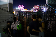 WASHINGTON, USA - September 15: People try to catch a glimpse of Three Doors Down through a fence as they perform at The Great Frederick Fair in Frederick, Md., USA on September 15, 2017.