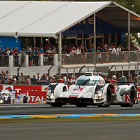 The #2 Audi R18 e-tron quattro and the #8 Toyota TS040 Hybrid battle it out at Le Mans 24H, 2014 (Saturday, 14 June)