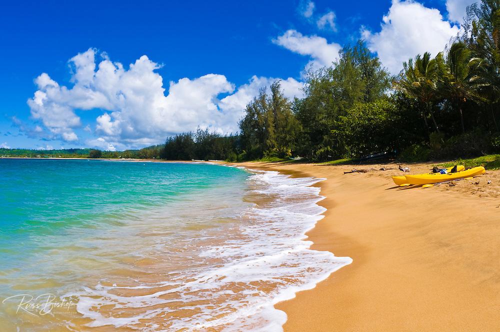 Kayaks on an empty beach at Hanalei Bay, Island of Kauai, Hawaii USA
