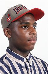 Portrait of teenage boy wearing baseball cap,