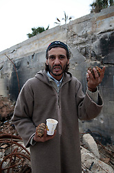 © licensed to London News Pictures. TRIPOLI, LIBYA  19/02/12. A man holds hand grenades he found in Bab Al Azizia, Muarmar Gaddafi's former compound in Tripoli, Libya. Much of it was destroyed by NATO bombing. Please see special instructions for usage rates. Photo credit should read MICHAEL GRAAE/LNP