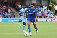 AFC Wimbledon defender Will Nightingale (5) dribbling during the EFL Sky Bet League 1 match between AFC Wimbledon and Coventry City at the Cherry Red Records Stadium, Kingston, England on 11 August 2018.