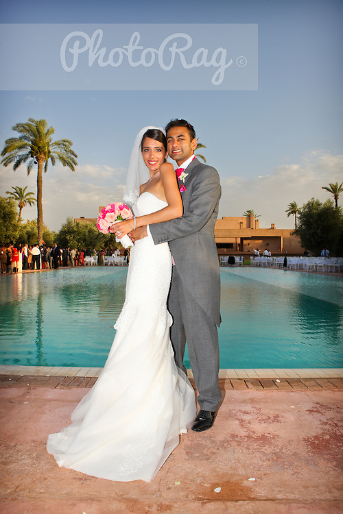 A young Indian couple marry abroad at an exclusive 5-star venue just outside Marrakesh in Africa's Morocco. In the heat of summer, the couple tied the knot in style, firstly at their colourful 'Bollywood Style' Indian wedding and later with a second party following a more traditional 'White Wedding' format.