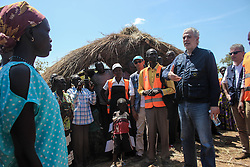 EU Commissioner CHRISTOS STYLIANIDES assures a group of refugees that they will be recieving aid. During his trip, the Commissioner went to BidiBidi settlement in Northern Uganda, now the third largest refugee settlement in the world. It currently holds more than 210,000 South Sudanese refugees escaping from war, and the ongoing influx of a daily average of 3,000 refugees is causing a strain on humanitarian aid and funding.