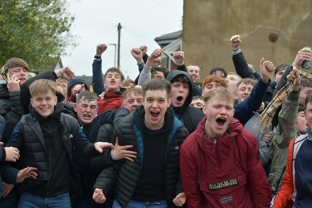 8th May 2021, Cheltenham, England. Cheltenham Town fans celebrate as the side won the league and promotion into League one. Fans celebrating outside the stadium as they are unable to attend due to covid 19.
