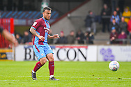 Clayton Lewis of Scunthorpe United (15) passes the ball during the EFL Sky Bet League 1 match between Scunthorpe United and Bradford City at Glanford Park, Scunthorpe, England on 27 April 2019.