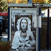 KRO reclame in bushokje Huizermaatweg Huizen, heilige maagd maria met blote borst en kind