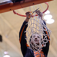022715       Cable Hoover<br /> <br /> Gallup Bengal Cori Gordon (4) snips off a piece of the net as the Bengals celebrate their district championship win over the Farmington Scorpions Friday at Gallup High School.