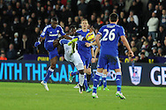 Swansea city's Marvin Emnes © is challenged by Ramires of Chelsea. Barclays Premier League match, Swansea city v Chelsea at the Liberty Stadium in Swansea, South Wales on Saturday 17th Jan 2015.<br /> pic by Andrew Orchard, Andrew Orchard sports photography.