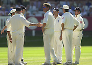 02-08-2003.Photo Peter Spurrier..Second Test - England v South Africa - Lords.Antony McGrath, [left] shakes hand with  Ashley Giles after Giles take the wicket of Mark Boucher caught Mark Butcher. [Mandatory Credit - Peter Spurrier:Intersport Images]