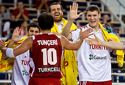 Team of Turkey celebrates  during the EuroBasket 2009 Group F match between Turkey and Serbia, on September 14, 2009 in Arena Lodz, Hala Sportowa, Lodz, Poland.  (Photo by Vid Ponikvar / Sportida)