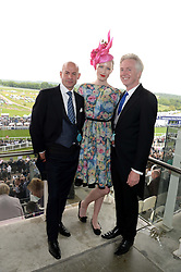 Left to right, STEFAN BARTLETT, JADE PARFITT and PHILIP TREACY at the Investec Derby 2013 held at Epsom Racecourse, Epsom, Surrey on 1st June 2013.