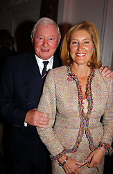 SIR DONALD GOSLING and GABY DI NORA at a party hosted by jeweller Theo Fennell and Dominique Heriard Dubreuil of Remy Martin fine Champagne Cognac entitles 'Hot Ice' held at 35 Belgrave Square, London, W1 on 26th October 2004.<br />