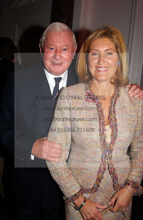 SIR DONALD GOSLING and GABY DI NORA at a party hosted by jeweller Theo Fennell and Dominique Heriard Dubreuil of Remy Martin fine Champagne Cognac entitles 'Hot Ice' held at 35 Belgrave Square, London, W1 on 26th October 2004.<br /><br />NON EXCLUSIVE - WORLD RIGHTS