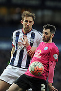 Peterborough's Michael Smith (2) is challenged by West Brom's Gareth McCauley. The Emirates FA Cup, 4th round match, West Bromwich Albion v Peterborough Utd at the Hawthorns stadium in West Bromwich, Midlands on Saturday 30th January 2016. pic by Carl Robertson, Andrew Orchard sports photography.