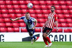 Alfie Kilgour of Bristol Rovers heads the ball away from Will Grigg of Sunderland - Mandatory by-line: Robbie Stephenson/JMP - 12/09/2020 - FOOTBALL - Stadium of Light - Sunderland, England - Sunderland v Bristol Rovers - Sky Bet League One