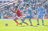 Alex Mowatt of Barnsley (27) is challenged by Tom Bayliss of Coventry City (20) during the EFL Sky Bet League 1 match between Barnsley and Coventry City at Oakwell, Barnsley, England on 30 March 2019.