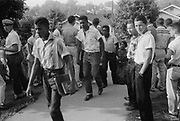 Line of African American boys walking through a crowd of white boys during a period of violence related to school integration, Little Rock, Arkansas,  4 December 1956. Photographer,  Thomas J O'Halloran.