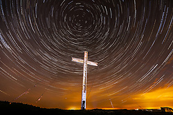 April 3, 2017 - Otley, Yorkshire, UK - Otley UK. Picture shows star trails over the Otley Chevin Cross in the early hours of this morning. The Cross that stands 30ft tall is placed on top of Otley Chevin every year to celebrate Easter & is made from salvaged timber from the bombed Arndale centre in Manchester. Picture is a composite of 90 images. (Credit Image: © Andrew Mccaren/London News Pictures via ZUMA Wire)